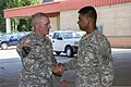 """U.S. Army Maj. Gen. Mike Murray, left, the commanding general of the 3rd Infantry Division congratulates Pfc. Paul Ieti for his performance on the television show """"America's Got Talent"""", during his visit 140626-A-HQ885-005.jpg"""