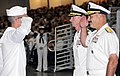 U.S. Navy Rear Adm. Mark D. Guadagnini, foreground right, deputy commander with fleet management and chief of staff of U.S. Fleet Forces Command, salutes Seaman Recruit Paul Coover for receiving the Navy League 120817-N-IK959-262.jpg
