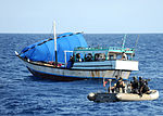 U.S. Sailors with the visit, board, search and seizure team embarked aboard guided missile cruiser USS San Jacinto (CG 56) investigate a suspicious dhow May 24, 2010, in the Gulf of Aden 100524-N-EF447-136.jpg