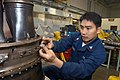 US Navy 030310-N-8726C-001 Aviation Machinist's Mate 2nd Class Manolito Pimentel, of Manila, Philippines, installs a thermal coupler on a T-56 turbine engine.jpg