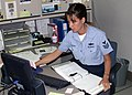 US Navy 030618-N-2893B-001 Information Technician 1st Class Annette Leasure takes a few minutes to fill out the BUPERS Online Uniform Survey Questionnaire.jpg