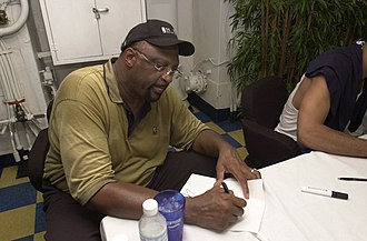 Bob Lanier (basketball) - National Basketball Association (NBA) Legend and Hall of Fame member Bob Lanier signs autographs for USS Nimitz sailors in 2003
