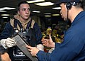 US Navy 031015-N-8955H-004 Lt. Cmdr. Michael Curtis from Congview, Wash., briefs Hull Maintenance Technician Fireman Jacob Styron.jpg