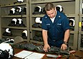 US Navy 040426-N-3770P-002 Aircrew Survival Equipmentman 3rd Class Sean Wilscam, of Edeen Prairie, Minn., performs a 90-day inspection on aircrew survival equipment.jpg