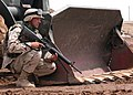 US Navy 040504-N-1261P-061 Justin Fellows assigned to Naval Mobile Construction Battalion Seven Four (NMCB-74) helps set a security perimeter at a project site near Fallujah, Iraq.jpg