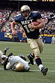 US Navy 041016-N-9693M-020 U.S. Naval Academy Midshipman 1st Class Frank Divis outpaces Notre Dame linebacker Brandon Hoyte for the Midshipmen's only touchdown of the game at Giants Stadium in East Rutherford, N.J.jpg