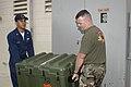 US Navy 041231-N-3207B-001 Lieutenant Pete Obenauer and Hospital Corpsman 2nd Class Richard Cabatit of Naval Environmental and Preventive Medicine Unit Six (NEPMU-6) prepare for deployment by packing entomology vector surveilla.jpg