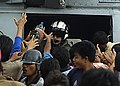 US Navy 050106-N-6817C-448 Indonesian citizens swarm an SH-60 Seahawk helicopter and its air crewman as relief supplies are passed out in a small village on the Island of Sumatra, Indonesia.jpg