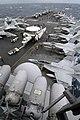 US Navy 050630-N-0120R-010 Air Department Sailors move an E-2C Hawkeye down the crowded flight deck.jpg