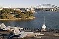 US Navy 050703-N-0167B-058 Sailors aboard the conventionally-powered aircraft carrier USS Kitty Hawk (CV 63) man the rails as the ship pulls into Sydney, Australia.jpg