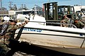 US Navy 050911-N-9712C-007 U.S. Navy Seabees assigned to Naval Mobile Construction Battalion Four Zero (NMCB-40), slide a boat onto a forklift.jpg
