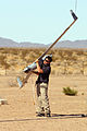 US Navy 060616-M-9508D-005 David Hilliard, a Boeing mechanic operator, retrieves a Boeing Scan Eagle Unmanned Aerial Vehicle (UAV) from a skyhook, a small suspended rope that catches the UAV out of mid-air.jpg