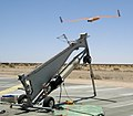US Navy 060619-M-8788S-004 An Unmanned Aerial Vehicle (UAV) called Scan Eagle launches off a pneumatic wedge catapult system to fly over Marine Corps Air Station Yuma for training in Desert Talon 2006.jpg