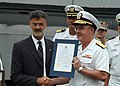 US Navy 060828-N-1805P-002 Chief of Naval Personnel, Vice Adm. John C. Harvey Jr. receives a certificate proclaiming Aug. 28 through Sept. 4, 2006, as Cleveland Navy Week, from Mayor Frank G. Jackson.jpg