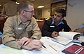 US Navy 070406-N-9851B-003 Submarine exercise planner, Lt. John Shuler, primary action officer for Exercise Malabar 07-01, discusses plans with Lt. Cmdr. Vivek Madhwal, Indian navy anti-submarine warfare officer for INS Rana (D.jpg