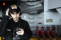 US Navy 070417-N-2060V-027 Aviation Boatswain's Mate Airman Chris Lemieux of Louisville, Ky., provides a progress update to a refueling station using a sound-powered phone aboard USS Kitty Hawk (CV 63).jpg