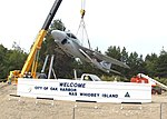 US Navy 070628-N-6247M-005 An A-6 Intruder is lowered by a crane into place at the gateway display on Highway 20 at the north end of the city.jpg