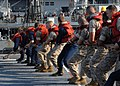 US Navy 070802-N-0841E-088 Sailors and Marines aboard amphibious transport dock USS Ponce (LPD 15) heave on the line in order to properly seat the fuel probe during a replenishment at sea.jpg