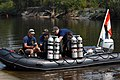 US Navy 070815-N-9610C-003 Divers assigned to the Explosive Ordnance Disposal Divisions of Naval Submarine Base Kings Bay and Naval Station Mayport prepare to dive into the Ogeechee River in search of old ordnance.jpg