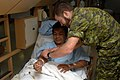 US Navy 070820-N-7088A-005 Lt. Leigh Aris, a member of the Canadian forces aboard Military Sealift Command hospital ship USNS Comfort (T-AH 20), prepares a patient who was recently operated on aboard Comfort for blood work.jpg