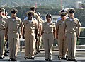 US Navy 070916-N-0194K-229 A group of newly pinned chief petty officers sing.jpg