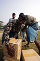 US Navy 071204-M-1226J-020 Bangladeshi Citizens, offload food rations from a Marine CH-46E assigned to Marine Medium Helicopter Squadron (HMM) 166 (REIN), 11th Marine Expeditionary Unit (MEU) Special Operations Capable (SOC).jpg