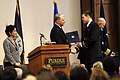 US Navy 071217-N-8273J-167 Chief of Naval Operations (CNO) Adm. Gary Roughead congratulates Ensign Joshua Fleming during a tri-service Reserve Officer Training Corps (ROTC) commissioning ceremony at Purdue University.jpg
