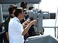US Navy 080626-N-4431B-375 Vietnamese Senior Capt. Nguyen Van Kiem, deputy chief of staff, Navy Command, watches through binoculars as a towed target is being set up.jpg