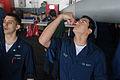 US Navy 081112-N-2344B-033 Storekeeper Seaman Jorge Diaz inhales a flu vaccine aboard the Nimitz-class aircraft carrier USS Ronald Reagan (CVN 76).jpg