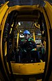 US Navy 090223-N-9928E-047 Storekeeper 3rd Class Calvin Wright waits to move supplies with a fork lift.jpg