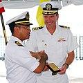US Navy 090810-N-5207L-059 Royal Brunei Navy Lt. Col. Spry bin Haji Seruji presents Capt. William Kearns III, commander of Task Group 73.5.jpg