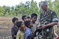US Navy 091011-N-9950J-324 ear Adm. Richard Landolt, commander, Amphibious Force U.S. 7th Fleet, shows his Blackberry to children from Hula Banda village while delivering ShelterBoxes to earthquake victims in remote villages.jpg