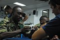 US Navy 091208-N-9999X-795 Sailors assigned to Mobile Diving and Salvage Unit (MDSU) 2 teach Tanzanian Peoples Defense Force Navy sailors proper knot tying.jpg