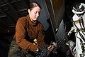 US Navy 100129-N-3327M-115 A sailor secures an aircraft aboard USS Nimitz.jpg
