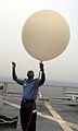 US Navy 100323-N-6676S-011 Nigerian navy Cmdr. Godffrey Kwetishe fills a weather balloon with helium.jpg