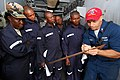 US Navy 100407-N-6138K-005 Damage Controlman 1st Class Corry Webb, from Dearborn Heights, Mich., teaches sailors from Gambia, Liberia, and Sierra Leone the proper procedure for measuring shoring.jpg