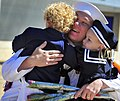 US Navy 100423-N-4774B-184 A Sailor assigned to the littoral combat ship USS Freedom (LCS 1) greets his children during a homecoming celebration after the ship's maiden deployment.jpg