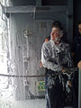 US Navy 100519-N-5503T-002 Machinist's Mate 1st Class Aaron Botts is covered in aqueous film forming foam during a countermeasure washdown.jpg