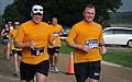 US Navy 100606-N-6046S-105 Capt. Doug McGowen, commanding officer of Naval Support Activity Mid-South, left, and Rear Adm. Anthony Gaiani, commander of Navy Region Midwest, participate in the inaugural Navy Ten Nautical Miler.jpg