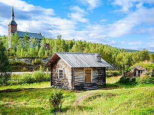 Utsjoki Church and a log cabin