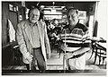 Vaste gasten van café Van den Heuvel aan het Spaarne 66. Links Han (64) en Kees (62). NL-HlmNHA 54037335.JPG