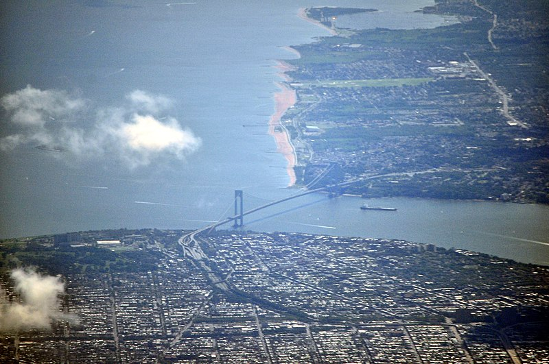 Aerial view of the Verrazano-Narrows Bridge, one of the world's longest suspension bridges, connecting Brooklyn, foreground, to Staten Island, in the background, across The Narrows.