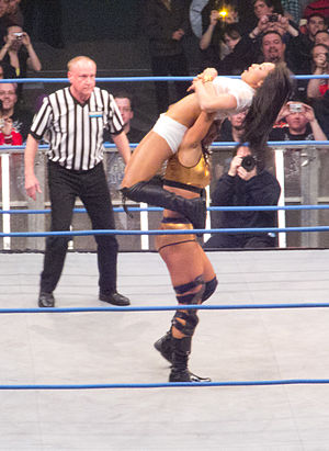 Neckbreaker - Tara setting up the Widow's Peak (gory neckbreaker) on Gail Kim