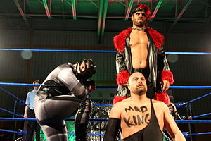 Eddie Kingston - Kingston (bottom) with Volgar (left) and Jimmy Jacobs (right) as part of the Flood in September 2014