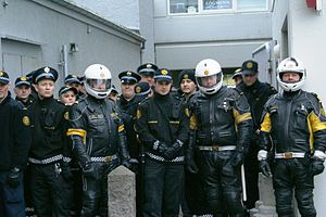 Icelandic Police - Motorcycle officers and normal officers during the 2008 protest at Hótel Borg. These motorcycle uniforms have now be replaced by a new uniform.