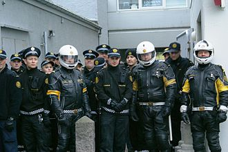 Icelandic Police - Motorcycle officers and normal officers during the 2008 protest at Hótel Borg. These motorcycle uniforms have now been replaced by a new uniform.