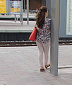 Waiting woman on perron.jpg