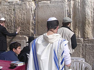 Flag of Israel - A traditional tallit with the blue stripes
