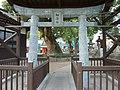 White porcelain Torii at Matsubara Shrine.jpg