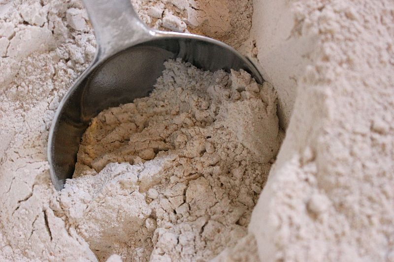 File:Whole wheat grain flour being scooped.jpg